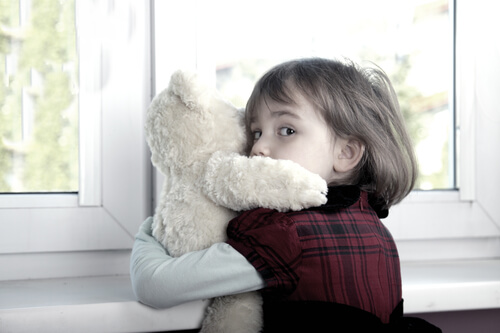Photo of frightened child, a common result in legal matters involving family violence, an area of family law handled by attorneys at The Family Law firm, serving clients in Edmonton, Alberta and beyond
