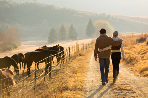 Photo of common law couple on Alberta farm, examples of the clients who regularly rely on the Family Law firm for legal help, delivered for their convenience by skype video consultations