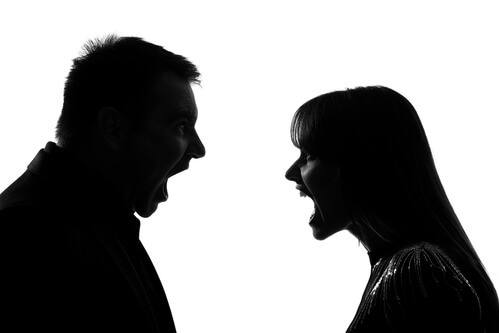 Photo of angry couple in a high conflict divorce, a demanding area of Family Law regularly handled by the court tested lawyers at the Family Law firm, offering legal services and legal advice to individuals caught up in a high stress divorce.