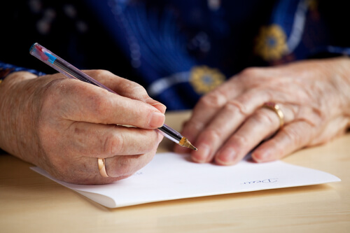 Photo of older man writing a will, an area of Wills and Estates planning handled by the lawyers at The Family Law term, who can answers your questions about will writing and the terminology used by Wills and Estates lawyers.