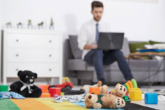 Photo of man in living room surrounded by children's toys seeking legal help for his family dispute